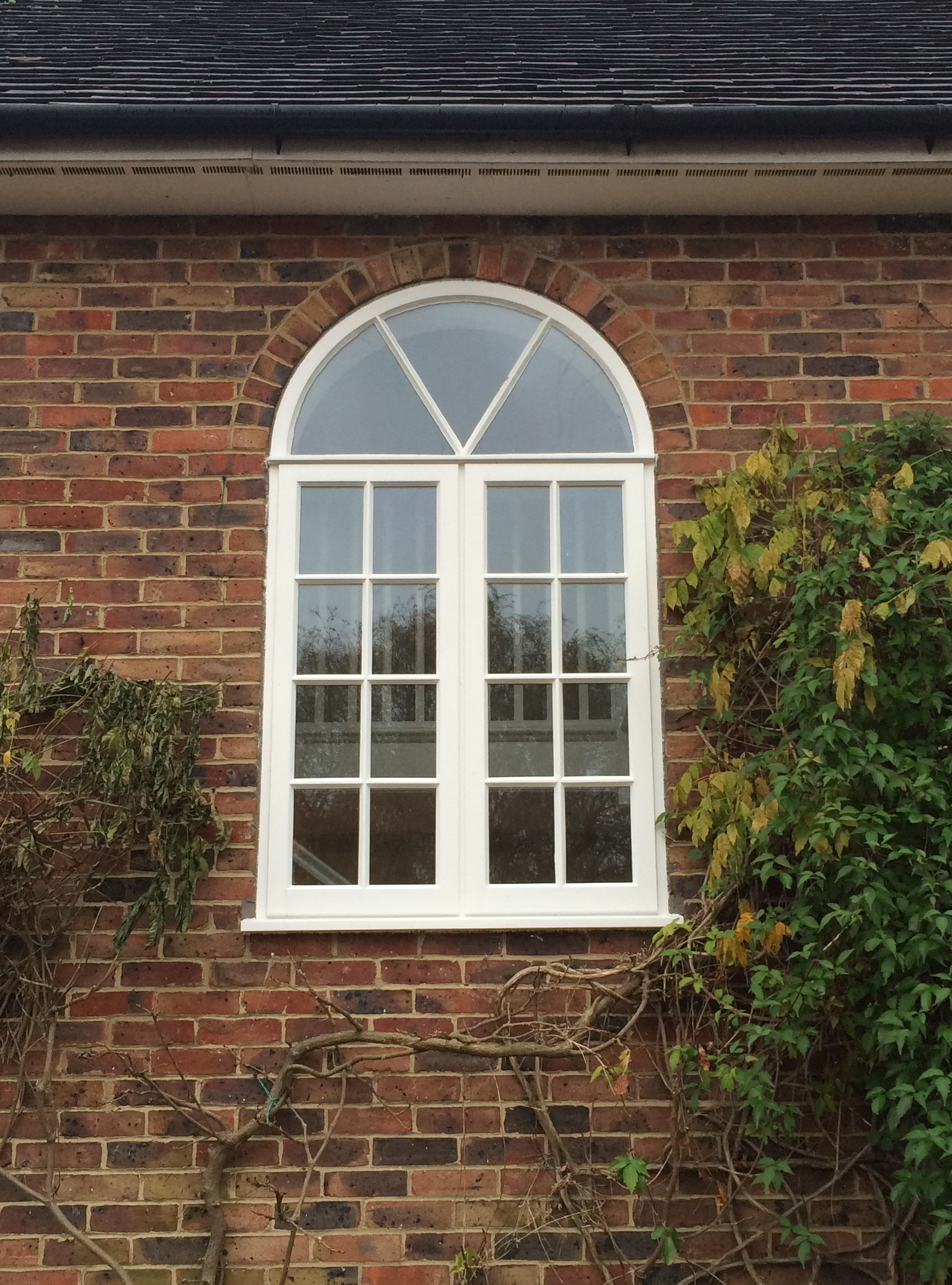window w semi circle fanlight